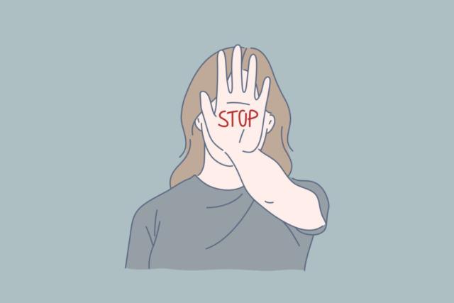 手のひらにSTOPと書いた女性のイラスト